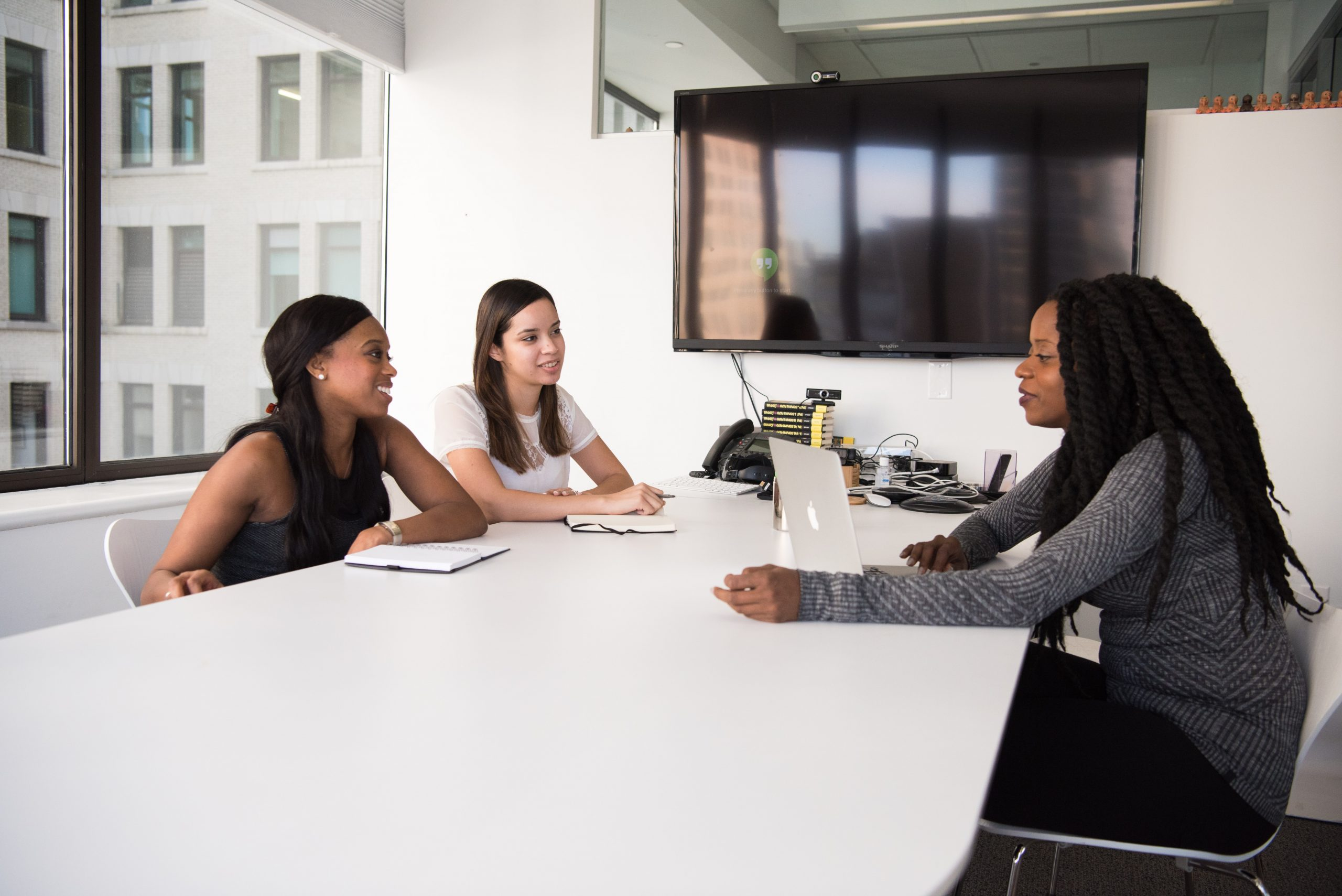 Women discussing business problems